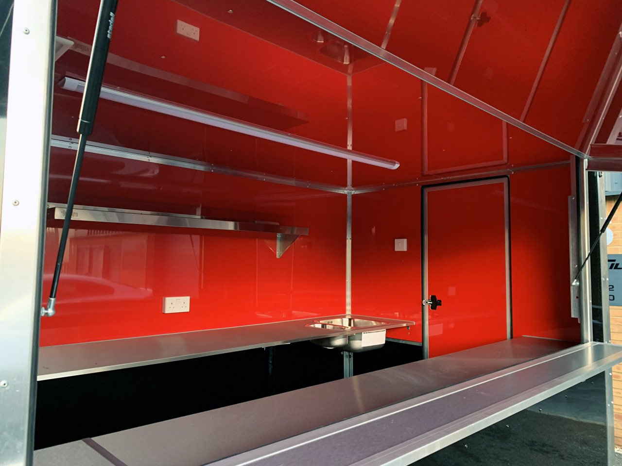 new custom built catering trailer red lining